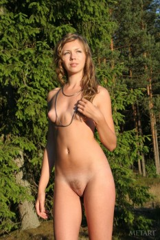 Skinny babe is having solo outdoors