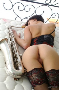 Sexy saxophone player takes off her sexy lingerie.