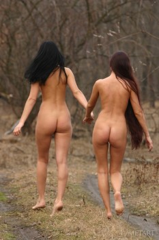 Two fun girls out for a naked walk in the woods