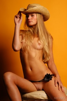Blonde cowgirl is one fine filly