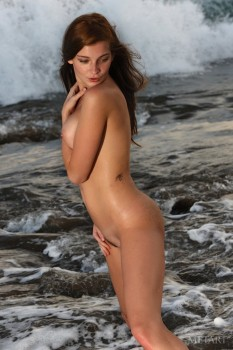 Hottie swims naked in the night sea