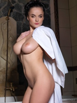 Stunning dark-haired cutie squeezes boobs in shower.