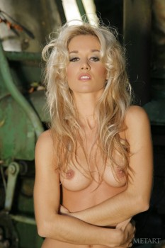 Blondie masturbates in her old tractor.