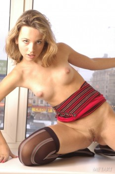 Half-naked hottie masturbates on the window-sill