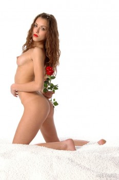 Naked princess is holding long red rose