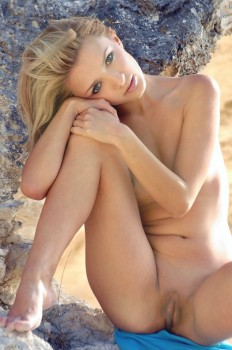 Sweetie poses for nude pictures on the beach.