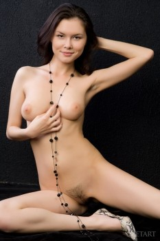 Hottie teases asshole with long black beads