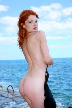 Ginger diva spends day naked at the seaside.
