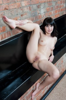 Flexible brunette is demonstrating solo skills
