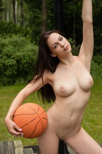 Brunette plays strip basketball outdoors