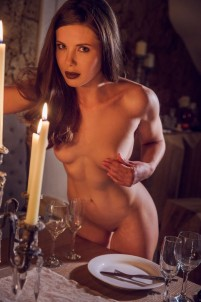 Brunette enjoys a romantic night all by herself