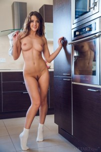 Naughty cutie gets satisfaction in the kitchen