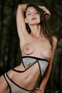 Dark-haired babe gets solo satisfaction in the forest