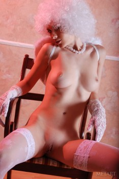 Sweet angel shows her naked beauty on chair
