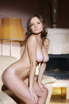 Long-legged brunette rubs butt, pussy and boobs