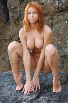 Redhead babe is enjoying solo in the river
