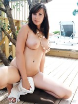 Brunette cutie with huge natural boobies