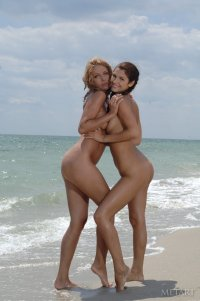 Naked lesbians orgasm together in a waves