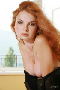 Ginger babe caresses her perfect body on camera
