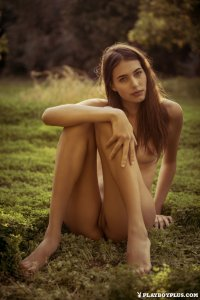 Hottie masturbates in green grass